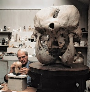 Image of Moore in his studio with the elephant skull given to him by  distinguished scientist Julian Huxley, who acquired it in East Africa.