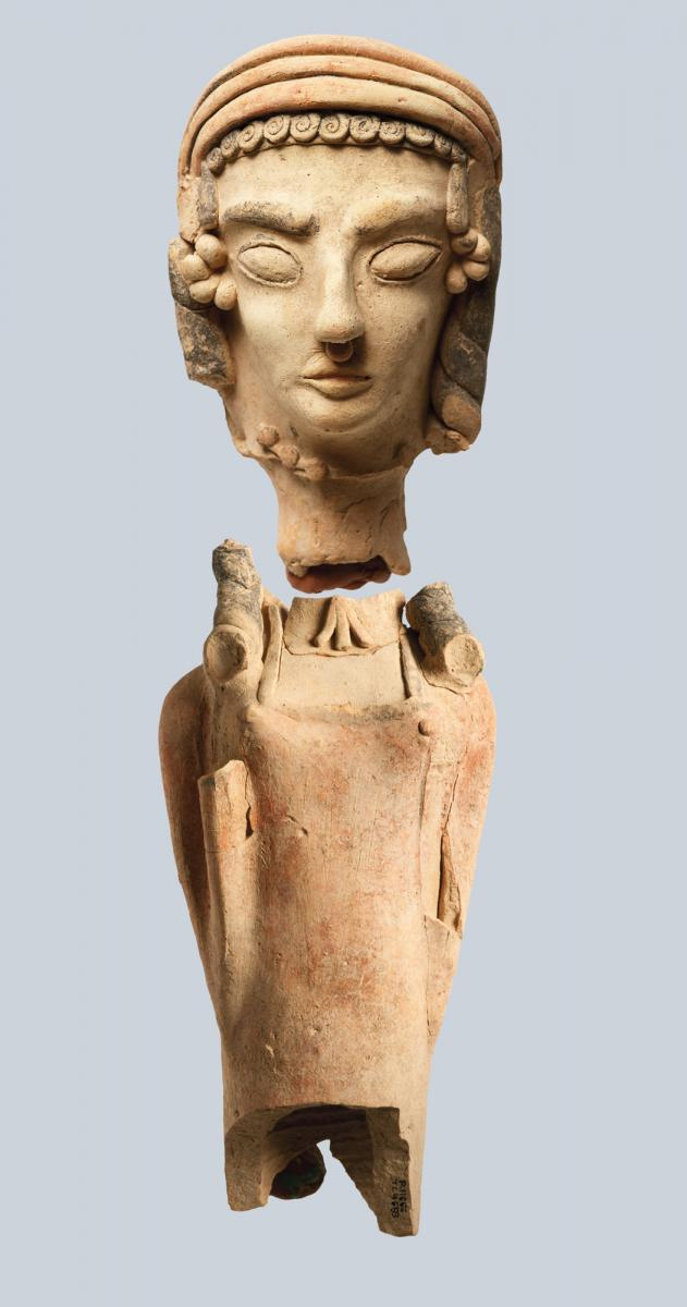 Cypriot, 6th century b.c.: Terracotta Female Statuette. Found by Princeton at Polis-Peristeries, in a votive pit in 1991. Terracotta with red and black paint, h. 16.3 cm (head), 22.91 cm (body). Polis Chrysochous, Local Museum of Marion and Arsinoe (Princeton Cyprus Expedition R11662/TC4681 [head], R11666/TC4683 [body]). Courtesy of the Department of Antiquities, Cyprus.