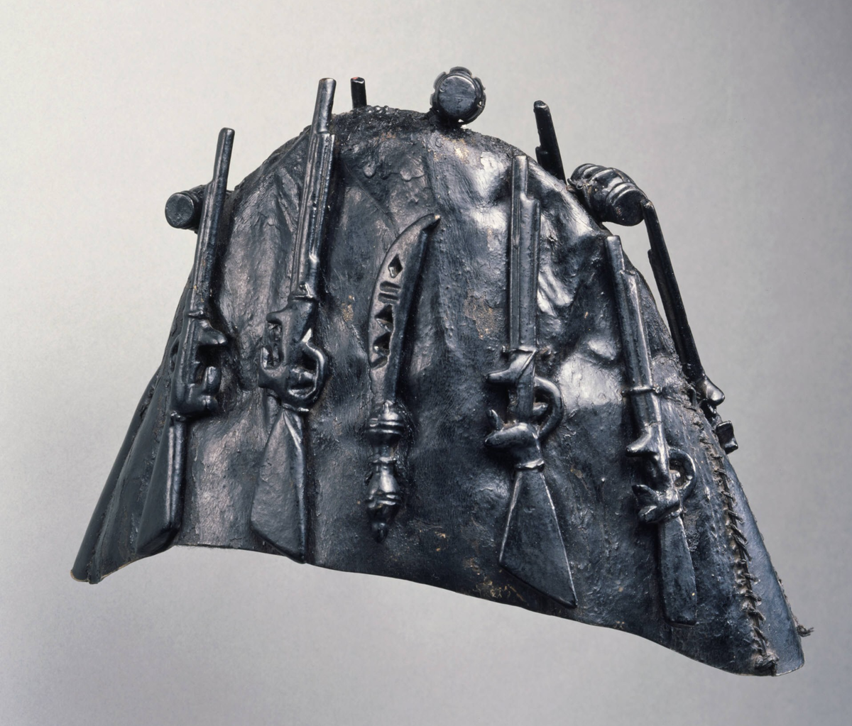 Akan artist, Ghana, Gun bearer or bodyguard's cap (krɔbɔnkyɛ), 19th century. Duiker rawhide, wood, paint, and leather. Bequest of John B. Elliott, Class of 1951
