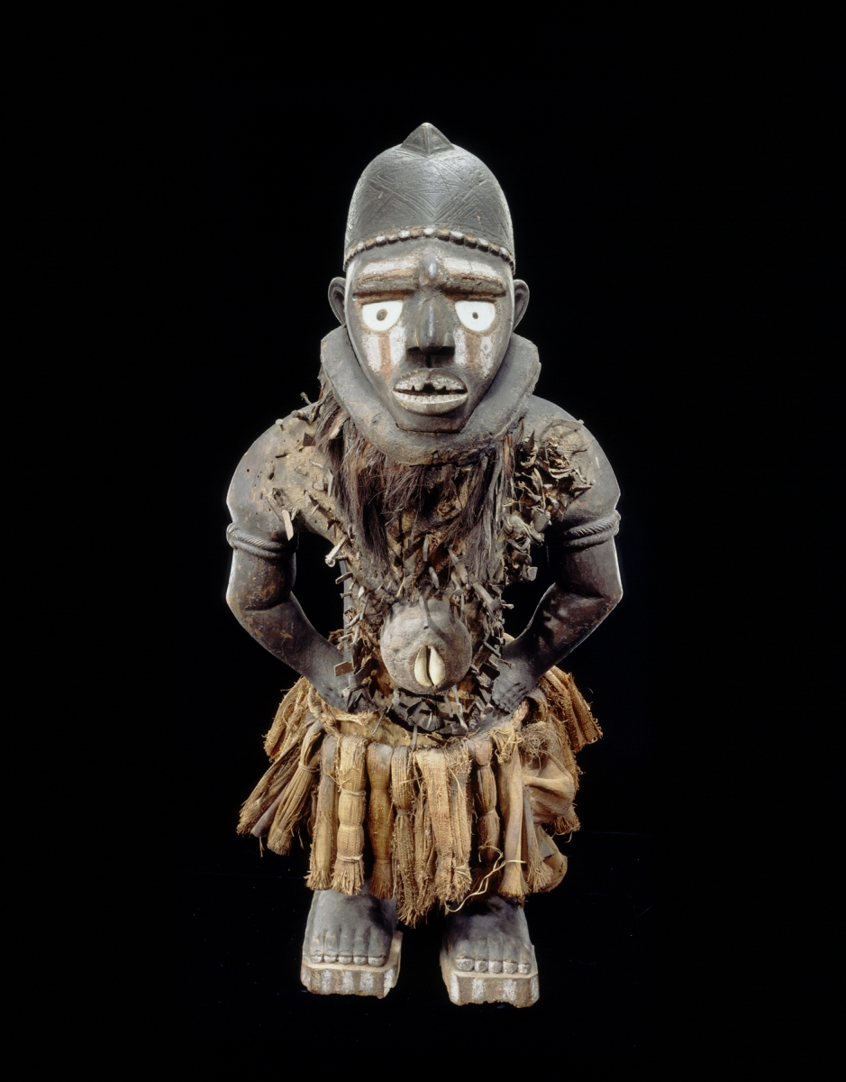 Yombe artist (Mayombe, Lower Congo, Democratic Republic of the Congo), Power figure (Nkisi Nkondi Mangaaka), 19th century. Wood, shell, vegetal fiber, metal, pigment, glass. Royal Museum for Central Africa, Tervuren, Belgium