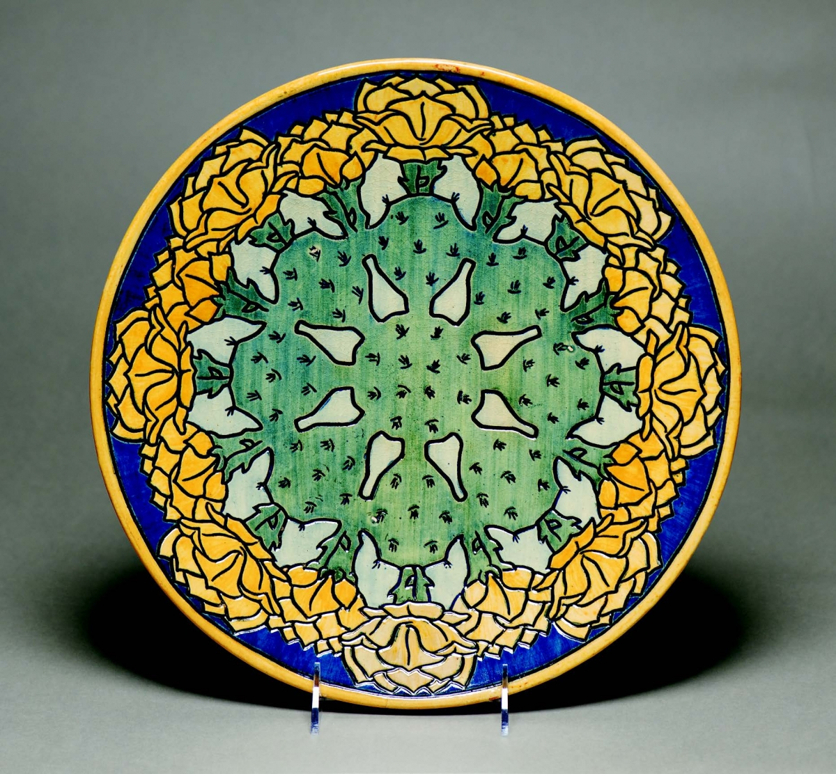 Esther Huger Elliot (decorator); Joseph Meyer (potter), Plate with a Design of Cactus Flowers, ca. 1904. Ceramic, diam. 32.7 cm. Collection of Caren Fine