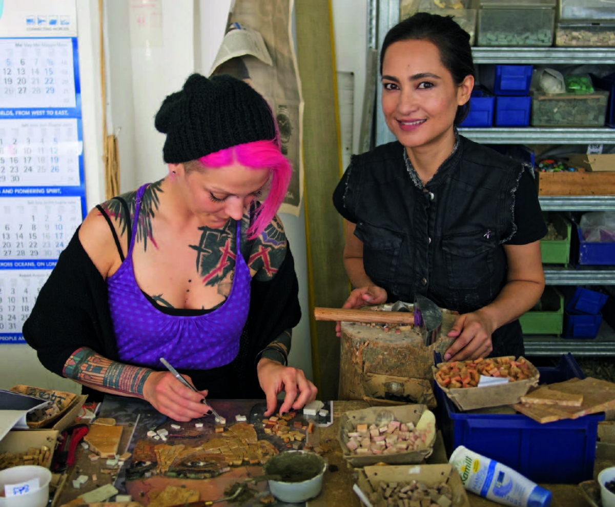 Shahzia Sikander and an artisan from Mayer of Munich working on the mosaic in Germany