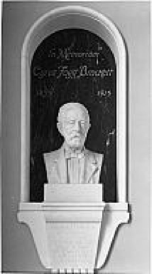 Marble plaque of Cyrus Fogg Brackett (1833–1915), designed by Joseph Schiller in 1911 and installed in Princeton University's Frist Student Center (PP80).