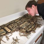 Aaron Stevens, Class of 2018, examining a naaxein (Chilkat) dance apron (PU 5257) as part of his senior thesis research into the Sheldon Jackson collection of Northwest coast material culture.