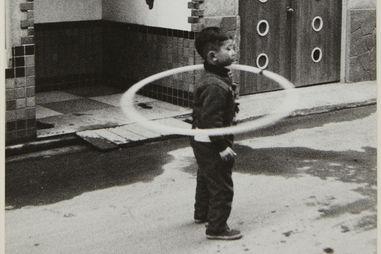 Kenji Ishiguro 石黒 健治. Boy with Hula Hoop. 1959. Gelatin silver print.